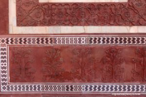 Beautiful flower design on the red sand stone